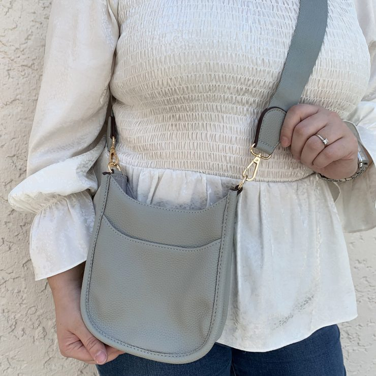 A photo of the Mini Messenger Bag In Light Grey product