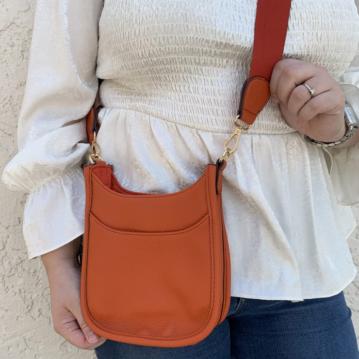A photo of the Mini Messenger Bag In Orange product