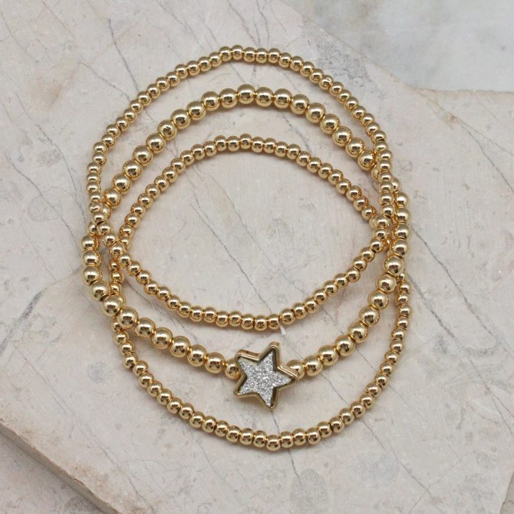 A photo of the Star Beaded Stack Bracelet Set product