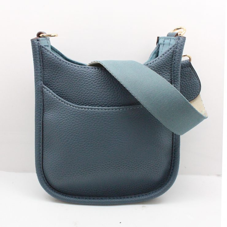 A photo of the Mini Messenger Bag In Denim product