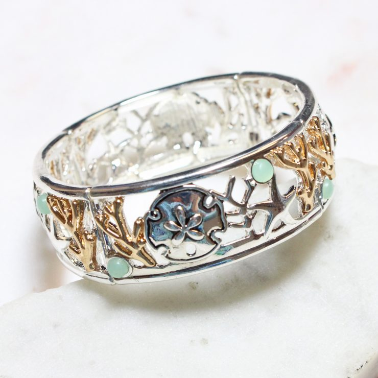 A photo of the Sea Life Bracelet In Two Tone product