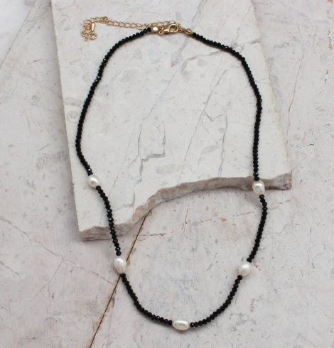 A photo of the Beaded Pearl Necklace In Black product