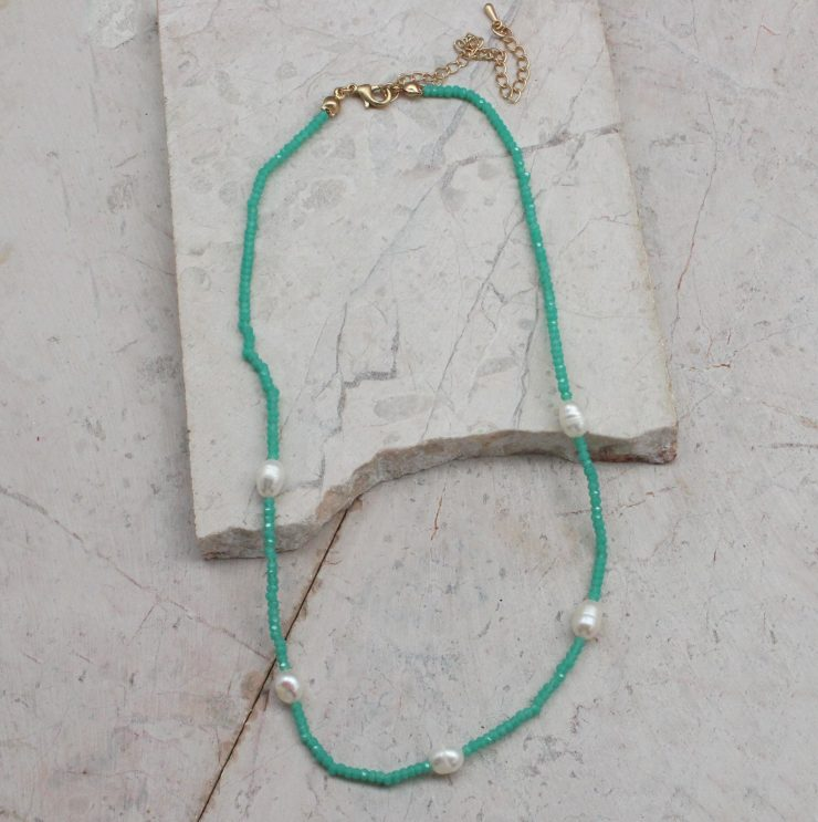 A photo of the Beaded Pearl Necklace In Mint product