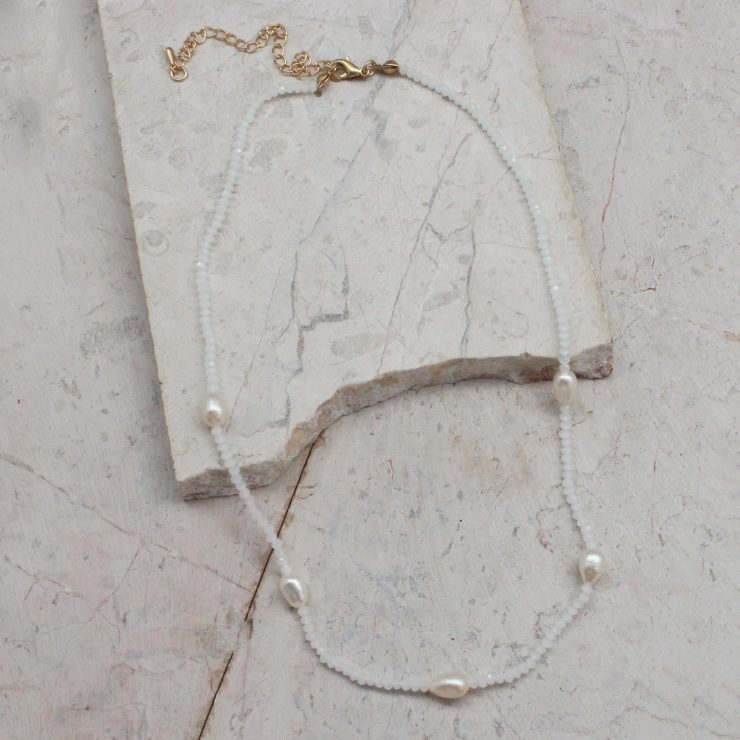 A photo of the Beaded Pearl Necklace In White product