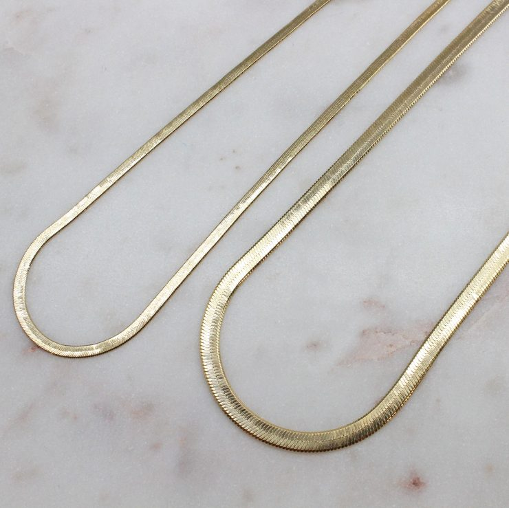 A photo of the Herringbone Chain In Gold product