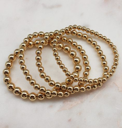 A photo of the Gold Beaded Bracelet Set Of 4 product