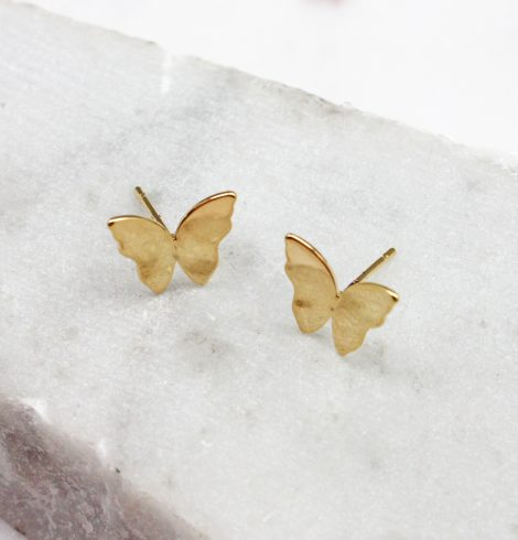 A photo of the Butterfly Stud Earrings In Gold product