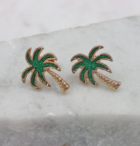 A photo of the Crescent Palm Earrings In Green product