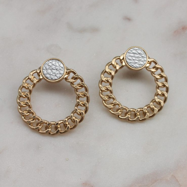 A photo of the Chained Earrings In Silver product
