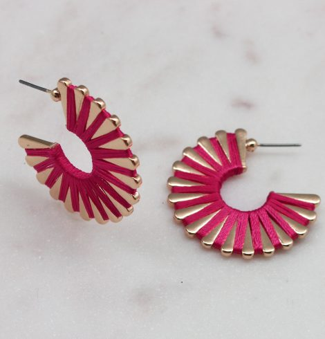 A photo of the Wound Up Earrings In Hot Pink product