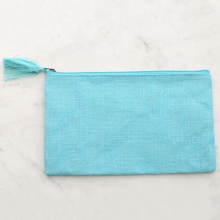 A photo of the Jute Cosmetic Bag In Aruba Blue product