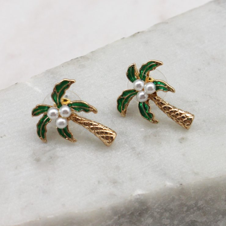A photo of the Palm Tree Studs In Green product
