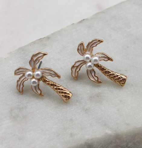 A photo of the Palm Tree Studs In White product