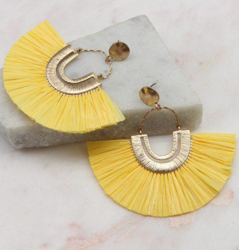 A photo of the Rita Raffia Earrings In Yellow product