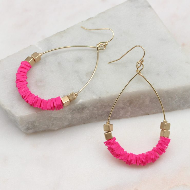 A photo of the Summertime Earrings In Pink product