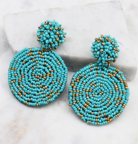 A photo of the Lizzy Earrings In Turquoise & Gold product