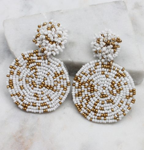 A photo of the Lizzy Earrings In White & Gold product