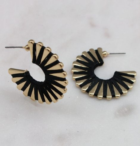 A photo of the Wound Up Earrings In Black product
