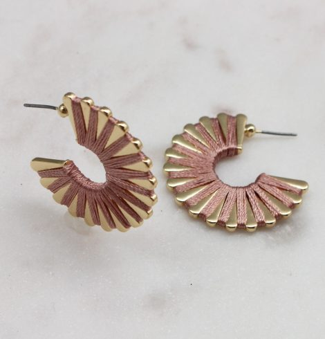 A photo of the Wound Up Earrings In Blush product