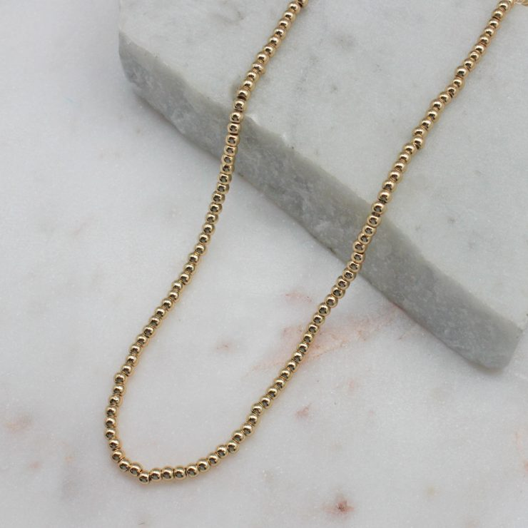 A photo of the Small Gold Beaded Choker product