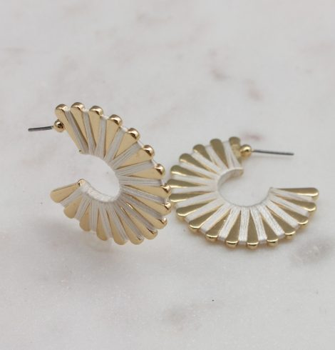 A photo of the Wound Up Earrings In White product