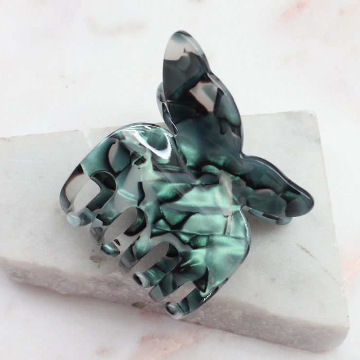 A photo of the Emerald Butterfly Clip product