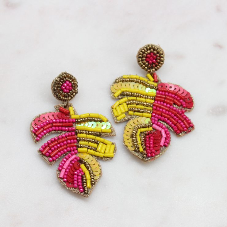 A photo of the Pink & Yellow Beaded Palm Earrings product
