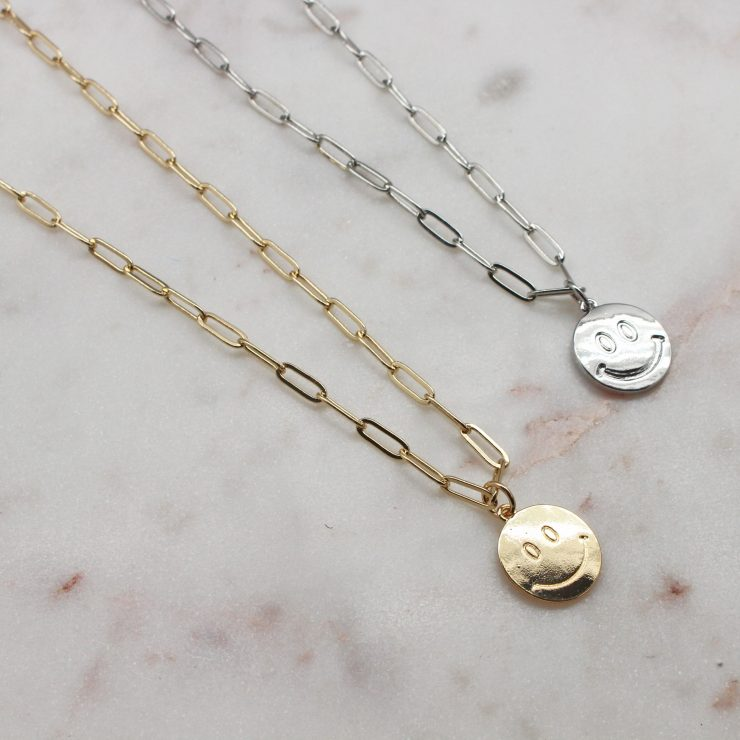 A photo of the Smiley Face Paper Clip Necklace product